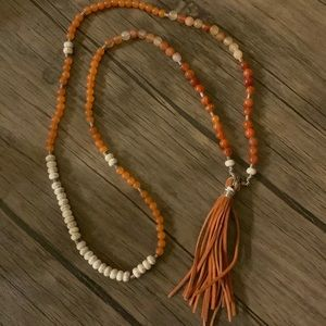 Leather tassel bead
